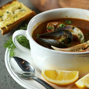 Cioppino, or fisherman's stew, is a great dish for entertaining and surprisingly simple to make. Better yet, it is very flexible, buy whatever seafood is fresh and inexpensive and you can't go wrong.