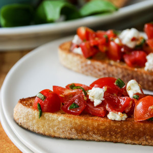 Bruschetta is one of those perfect foods. It is healthy, versatile, quick and inexpensive to make. It can be eaten as an appetizer or as an entire meal.