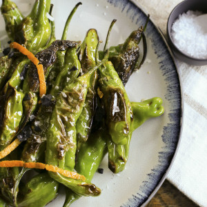 Pan-fried shishito peppers make a quick, economical and an addictively delicious happy hour snack.