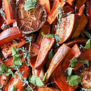 These delicious sweet potatoes are a mashup based on Ottolenghi and Ruth Reichl's recipes. Roasted in an orange juice, marmalade and angostura bitters glaze, they remind me of an Old Fashioned cocktail without the booze.